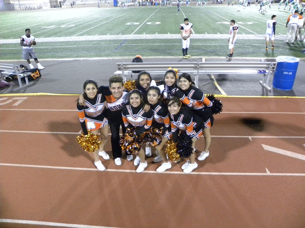 The Cheerleaders show their support with lots of spirit.