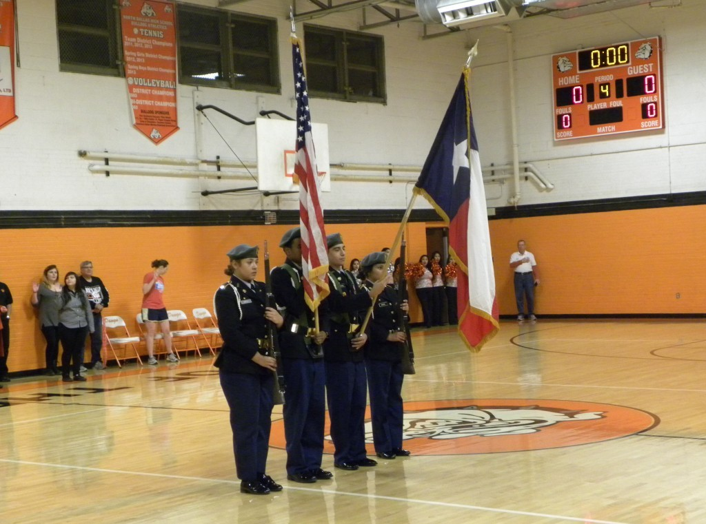 Battalion Commander Maria Garcia (left) leads the presentation of the flags.