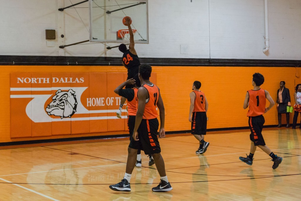 Forward Kobe Wrice goes up for a dunk in the Orange & White Classic