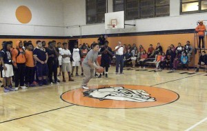 Anulfo Hernandez attempts the half-court shot.