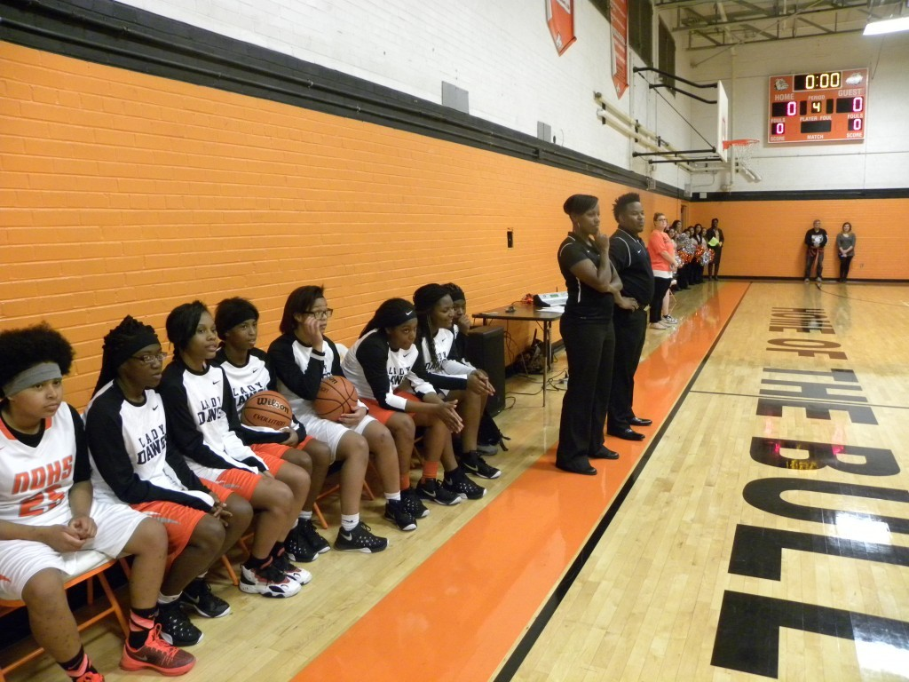 Girls coaches Desireé Allen and Erik Gayson watch the introductions.