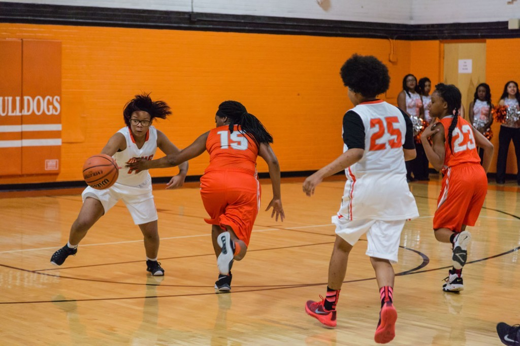 Myasia English (11) slips past Sharae Campbell in the girls scrimmage.