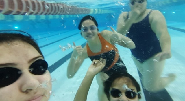Garcia sisters lead North Dallas swim team