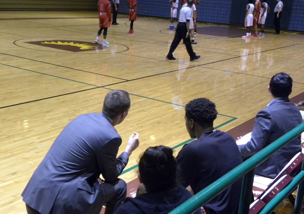 Coach Brett Cole and Kobe Wrice talk at the end of the game against Woodrow.