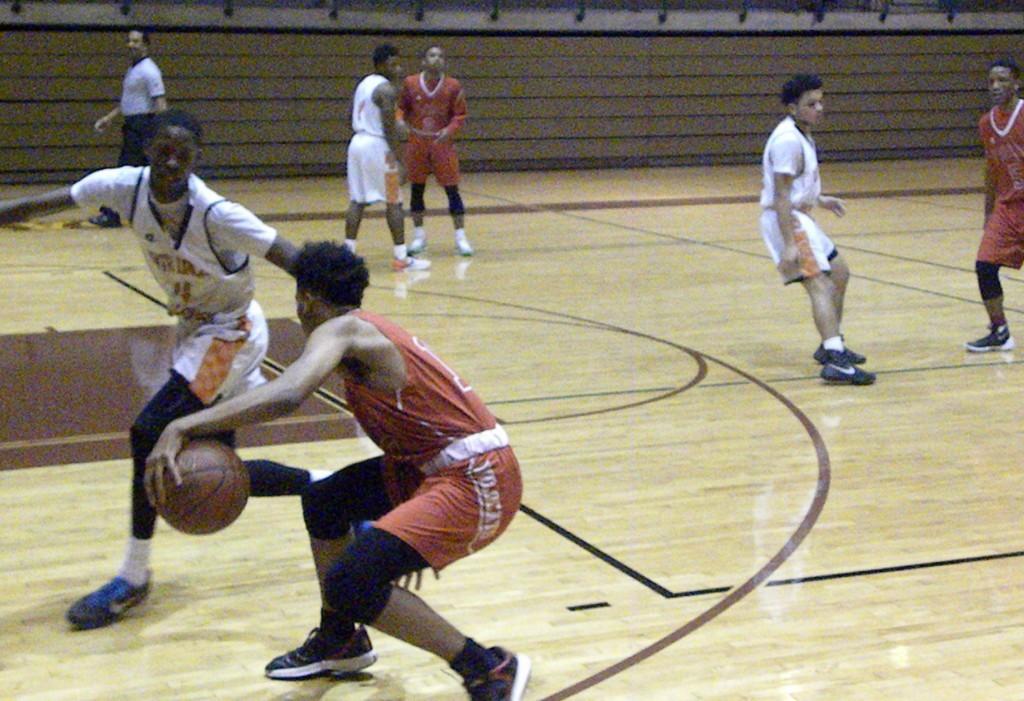 North Dallas guard Darius Watts defends against Woodrow.