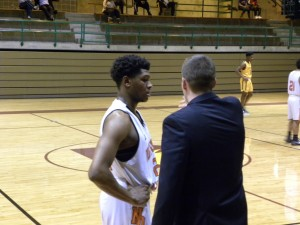 Kobe Wrice listens to Coach Brett Cole.