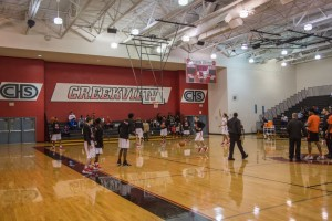 Carrollton Creekview's gym has bleachers all around their basketball court.