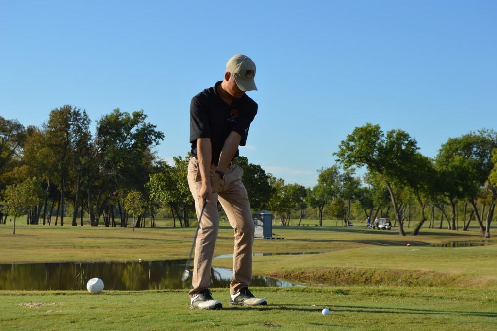 Leo Garcia takes a shot on the tee.