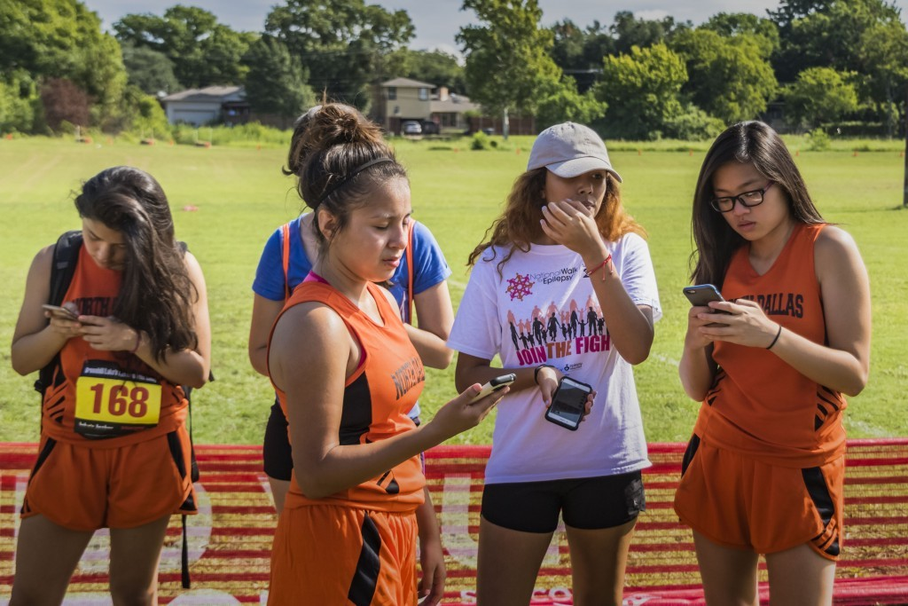 With relay race finished, the girls check their phones.