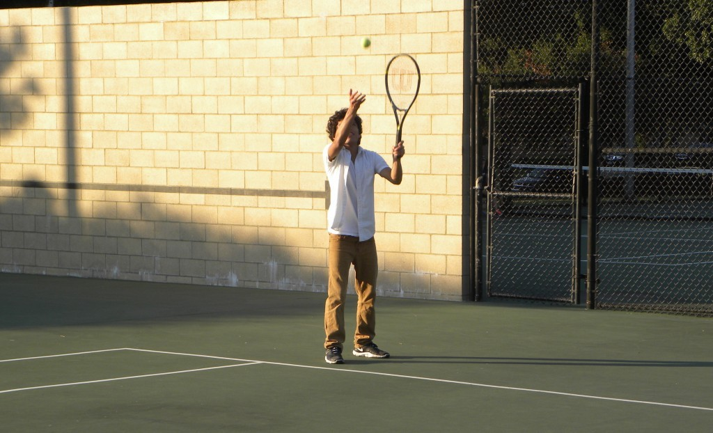 Kevin Rodriguez works on his serve.