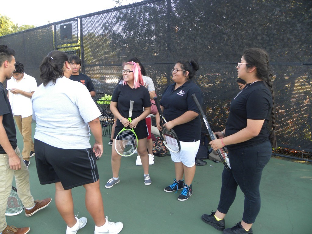 Anna Nguyen (middle) and her teammates enjoy a funny moment at a recent practice.