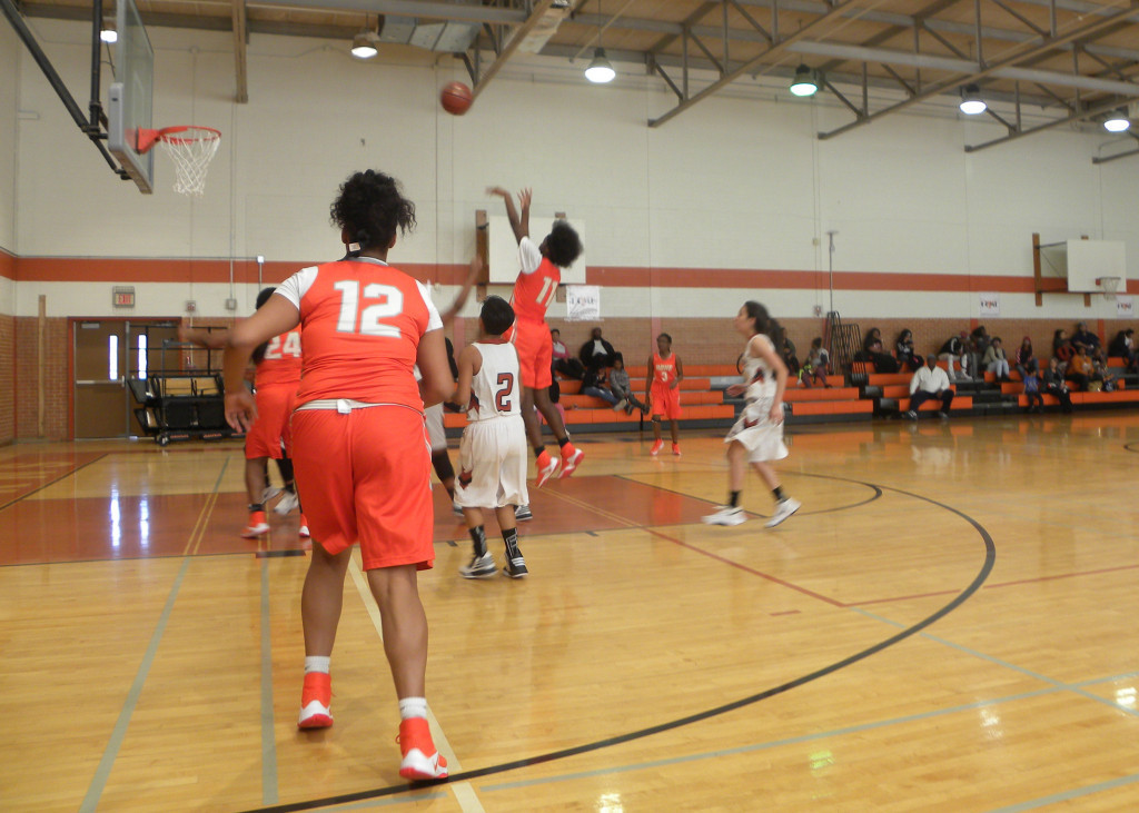 Jakolby Flemings shoots and scores against W.T. White.