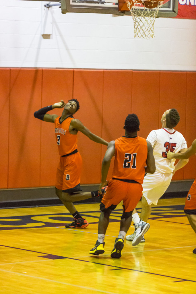 North Dallas' Christian Armstrong (3) watches his shot fall in against Bishop Dunne. Larry Cooper (21) trails the play.