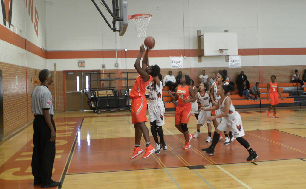 Teia Leroy puts up a shot against W.T. White. She finished with 8 points.