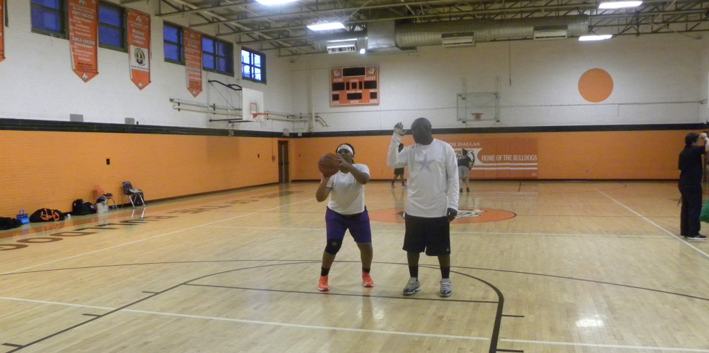 DaTiara Empy works on her free-throw shooting with help from Michael Lampkin.
