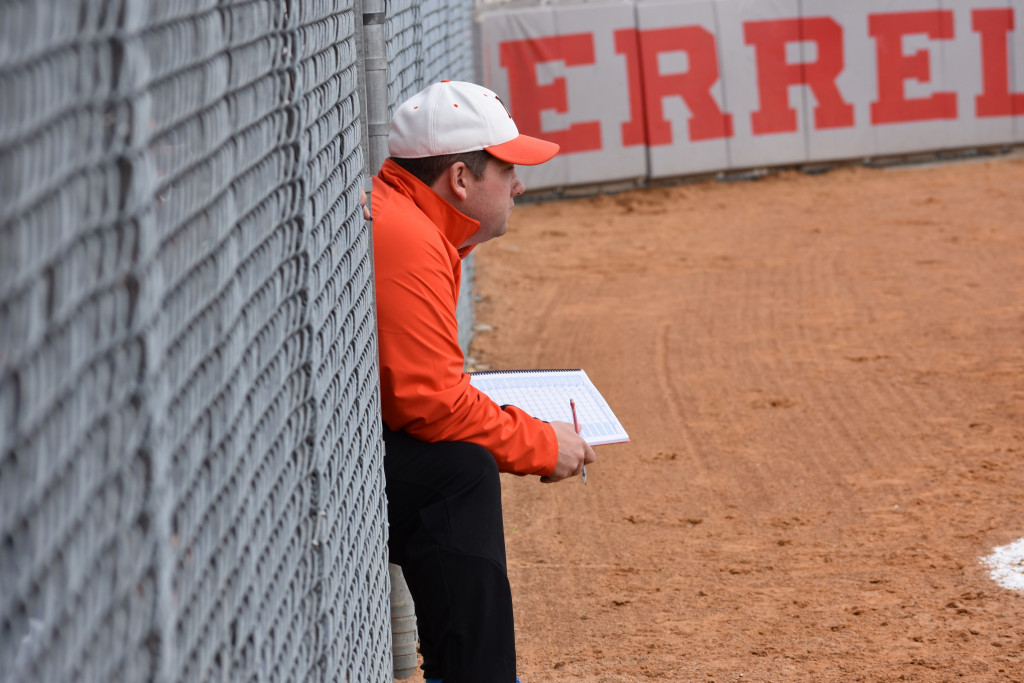 North Dallas softball coach Chris Barnhill keeps the stats from the dugout.