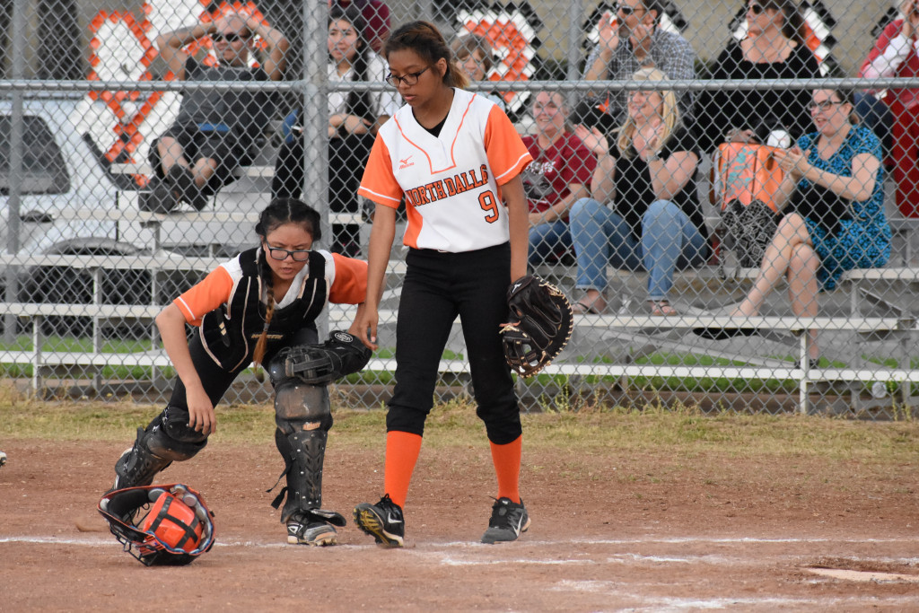 Senior Jannette Lopez helps catcher Duyen Lai at the plate.