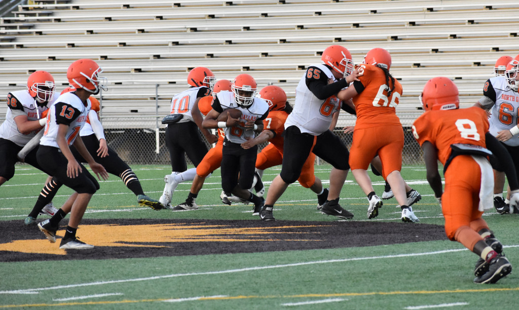 Stefhany Gonzalez (66) battles a teammate during the Orange and White Spring game.