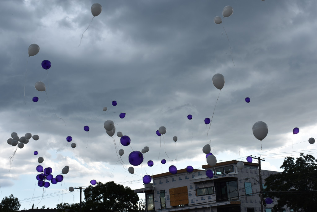 The purple and white balloons are released in memory of Ms. K.