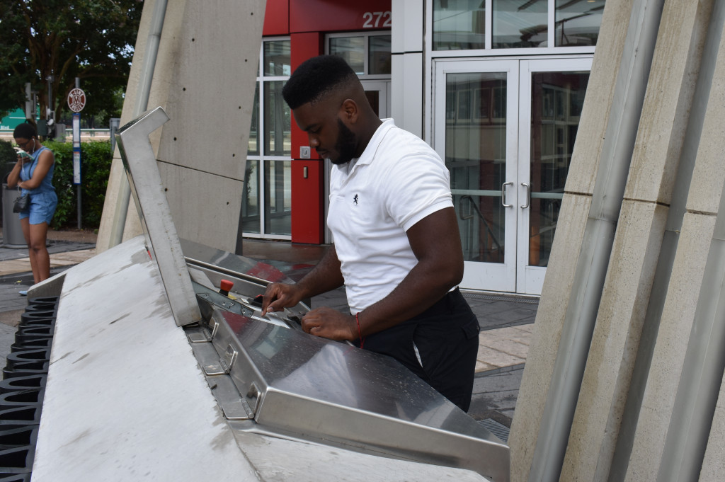 James Crayton operates the board at the Cityplace Station.