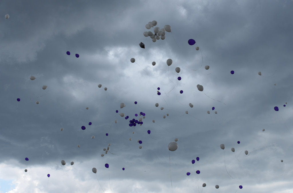 The sky was filled with purple and white balloons in honor of Ms. K.