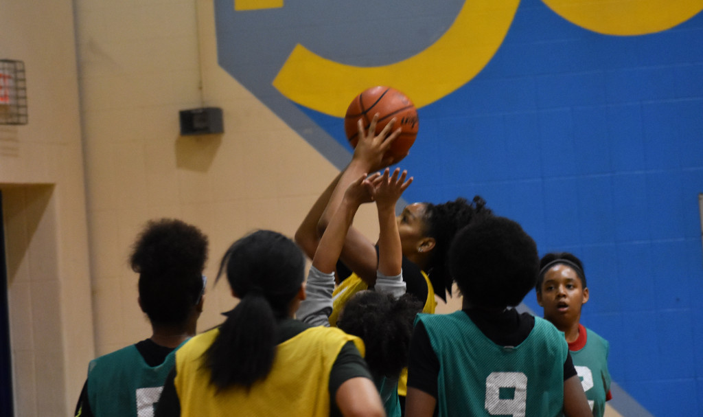 SaNiya Lampkin goes up for a shot during a scrimmage.