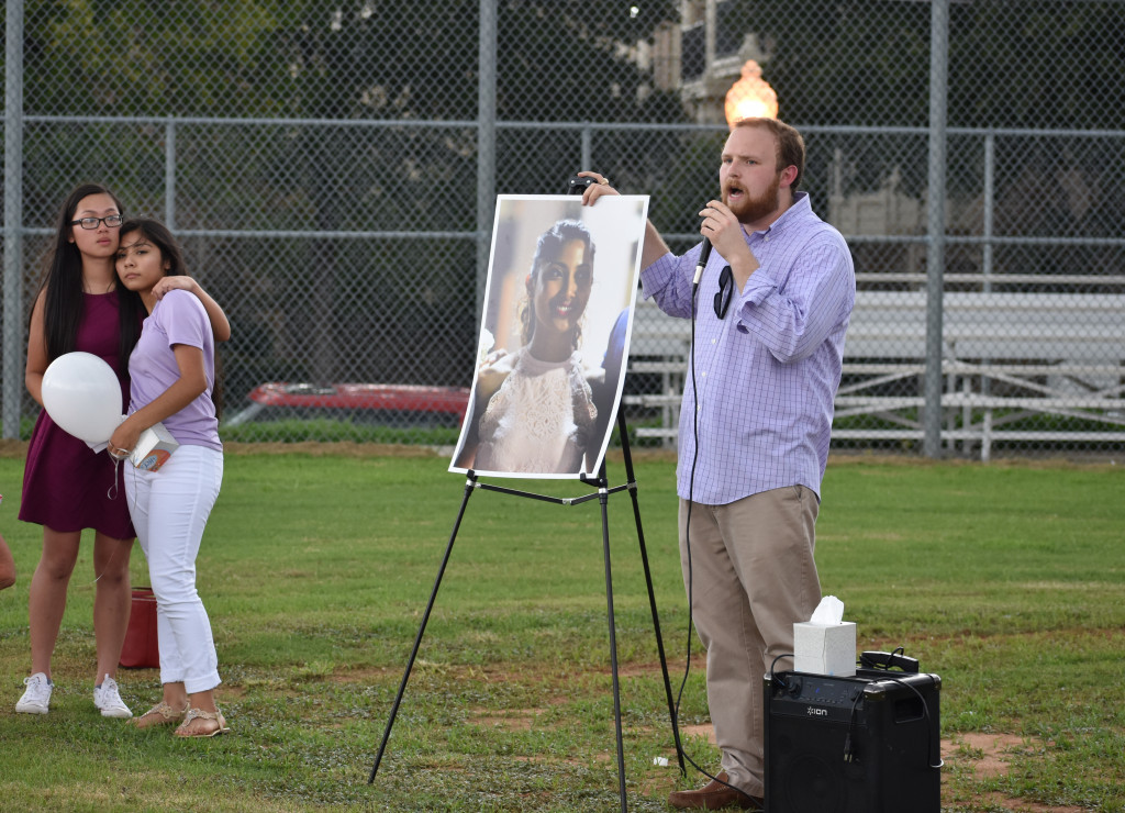 About 100 students, faculty and friends gathered on the North Dallas baseball field to remember Ms. Tammy K. Teacher Ryan Davenport talks to the attendees.
