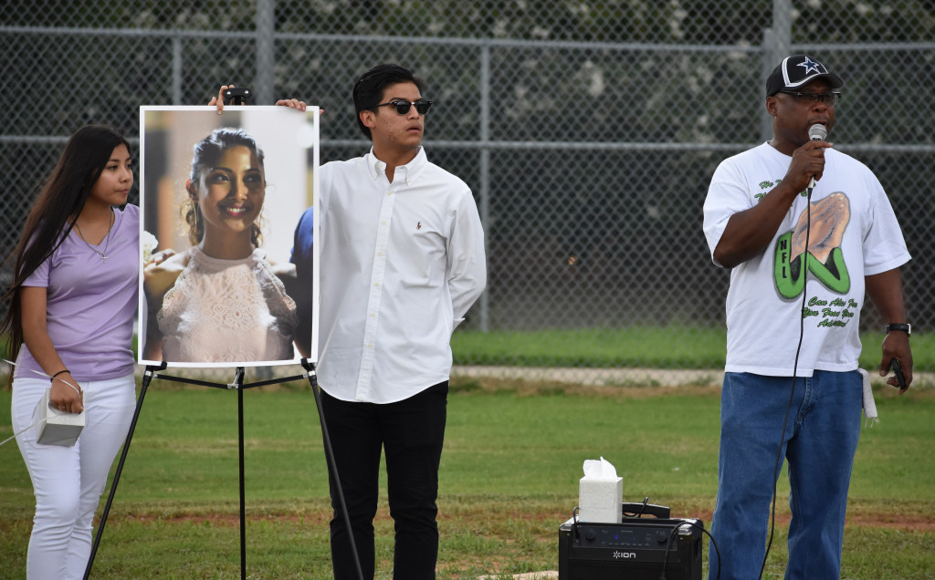 Pastor Lorenzo Brown of Central Dallas Church was among the speakers at the tribute for Ms. K on the ND baseball field. At left is Vanessa Gomez and Leo Campos.