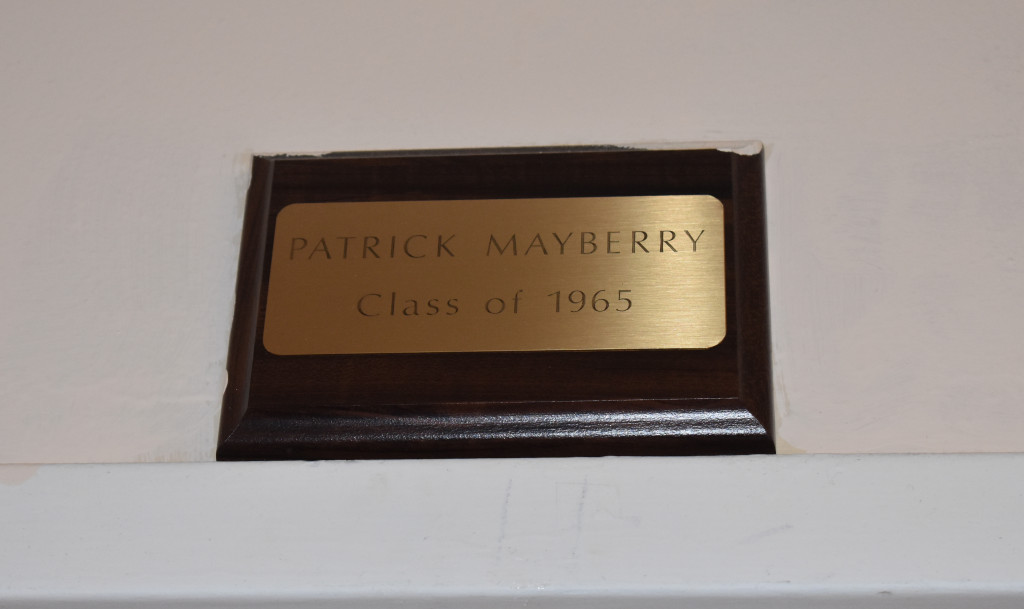 Patrick Mayberry's nameplate rests above the principal's room in the school office. The nameplate costs $500.