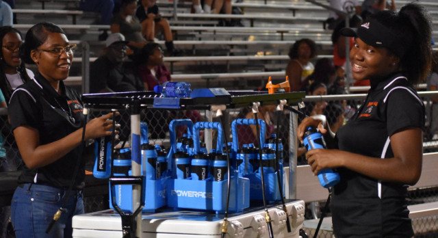North Dallas student aides are important to 'the health and safety of the team'