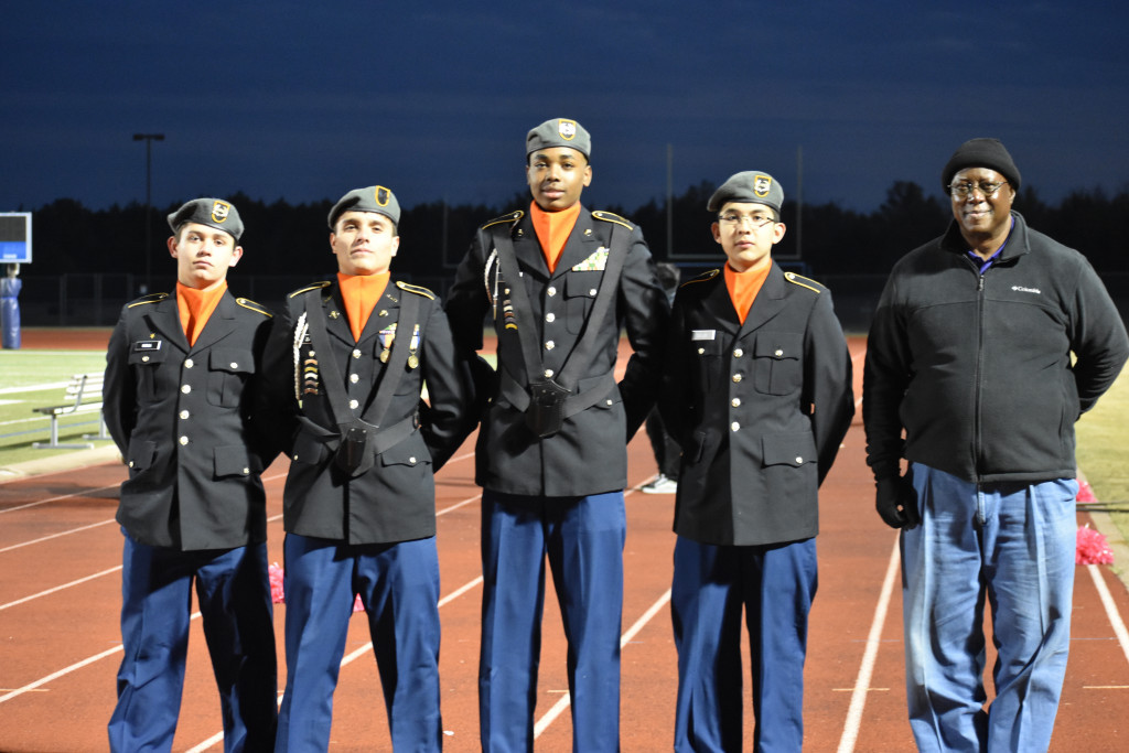 Color Guard members Jordan Mogo (from left), Alexis Zarate, Don'Tavious , Jose Sillos, and Sgt. Mark Nicholson arrive for presentation of the flags on Friday Wilmer-Hutchins Stadium.