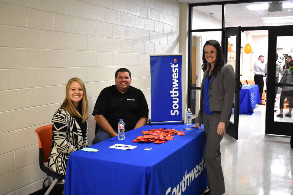 North Dallas Principal Katherine Eska visits with Brandi DeWaters, a specialist at Southwest Airlines, and Daniel Riskey, a recruiter with Southwest Airlines.