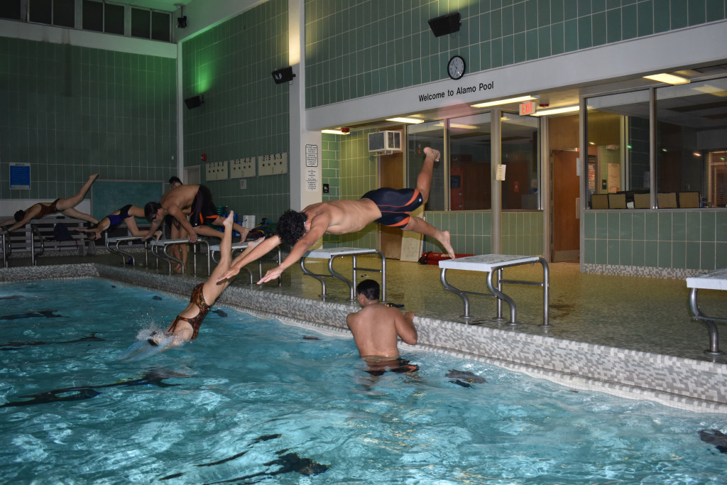 The North Dallas swimmers work on their starts in the pool.