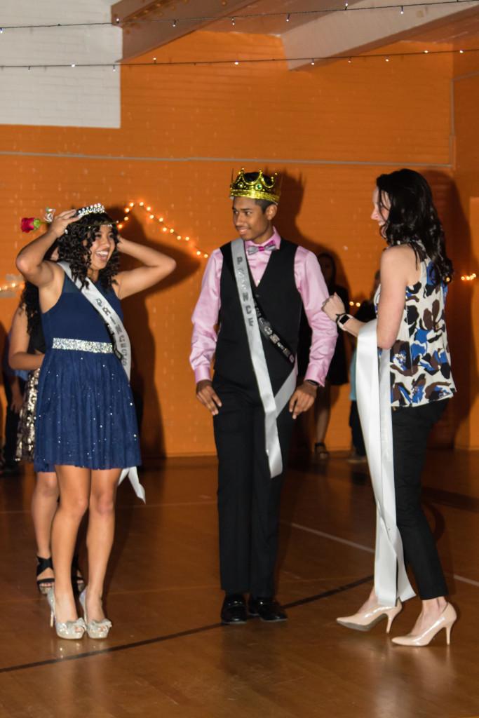 Xya Balderas tries on her crown as Modesto Ottenwarden looks on.