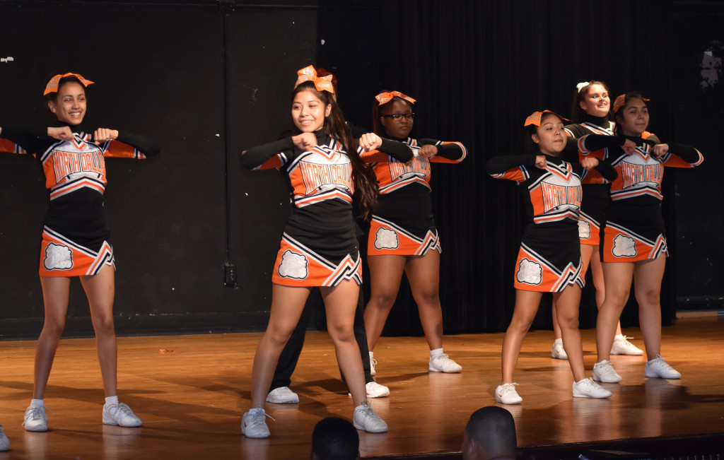 Vanessa Gomez leads the cheerleaders.