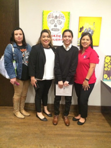 Toni Aza, Christina Herrera, and Rubi Chavez pose with North Dallas winner Cristian.