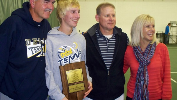 Bradley Wuthrich is flanked by Delta head coach Tim Cleland and Brad's parents, Steve and Anne Wuthrich, during Saturday night's award ceremony in Indianapolis.