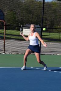 Delta singles player Ellie Snider hits a forehand shot