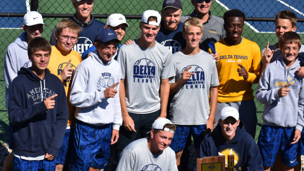 Tennis players with sectional trophy