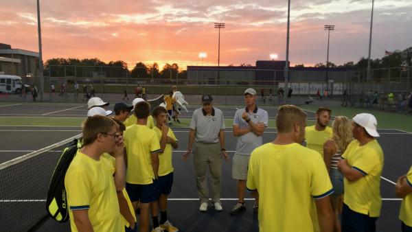 Players celebrate as sun sets