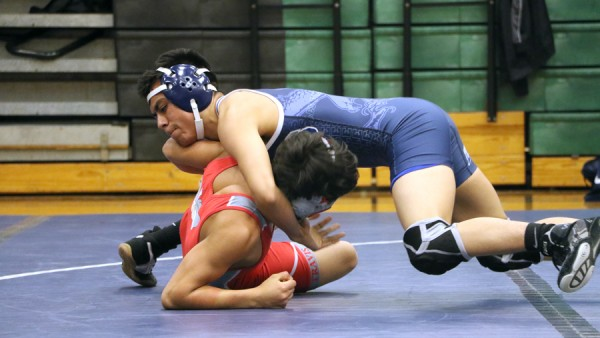 Robert Rodriguez goes against Travis High School opponent.
