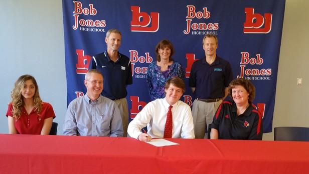 Derek Sander signs a swimming scholarship with the University of Louisville