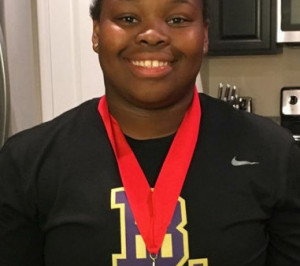Ty-Layshia West crushes her own school record with a throw of 42'10""