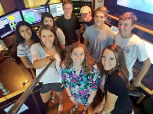 Senior volleyball players (R-L) Kristina Fisher, Bonnie Brode, Grace Ann Hornfischer, Ilisha D'Souza and Sarena Webster appeared live on Austin's Mix 94.7 radio, celebrating Taco Shack Bowl week. They're joined by Senior football players (L-R) Jacob Graves, James Baran, Wesley Engeling and Trey Lundquist.