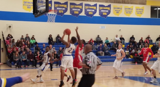 Boys Basketball Tames the Dragons in Home Opener