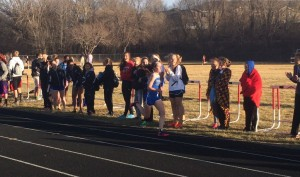 Cailey Henderson is cheered on in the 4x400.  Cailey won the 1600 earlier.