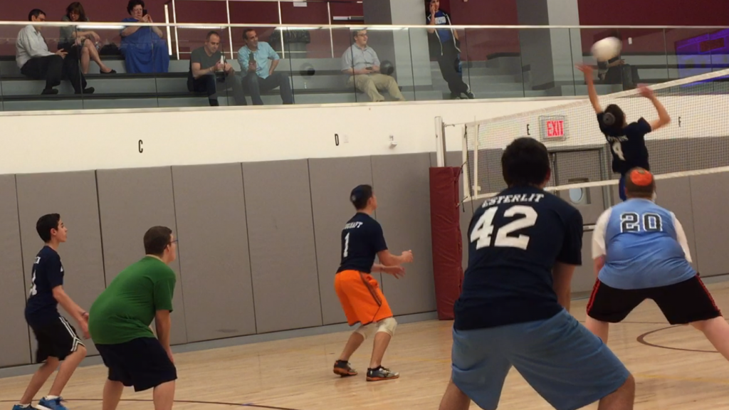 Simon Mendelsohn records one of his 3 blocks for points in his first volleyball match for Kushner.
