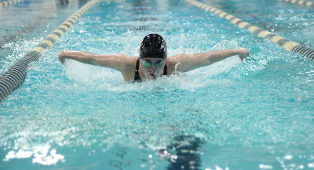 BRUNFMAN TAKES OVER CENTRAL SWIMMING