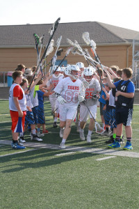 Fishers-HSE Youth lacrosse players welcome the varsity team.