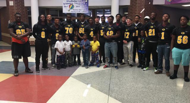 Greenwood Football Seniors Visit Woodfields Elementary